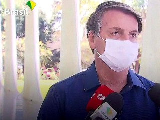 Watch President Bolsonaro tell reporters he has coronavirus, then take off his mask