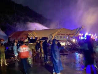 Air India plane with nearly 200 passengers crash lands, killing at least a dozen