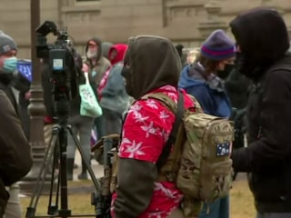 Armed protesters arrive at Michigan Capitol
