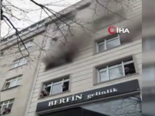 Children dropped from window of burning building in dramatic rescue