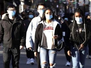 Debate grows over whether masks are still unnecessary outdoors