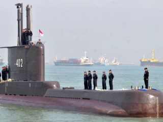 Rescuers race clock to find missing submarine before sailors run out of air