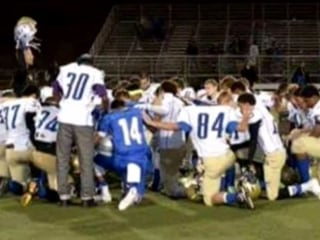 School District Investigates Coach for Post-Game Prayers
