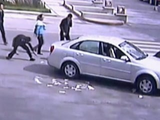 Bystanders Go to Grab Cash After Accident