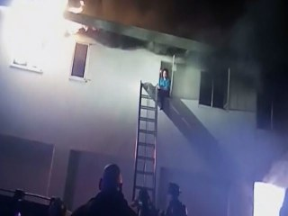 Caught on Camera: Women Rescued from Burning Building