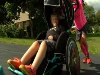 Father Strives to Push Son Across America