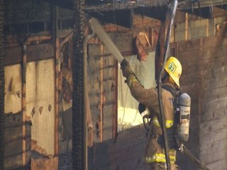 Rescuers Brave Flames