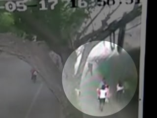Video Shows Wall Collapsing On Pedestrians in China