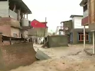 Flooding Turns Streets Into Rivers In Kashmir