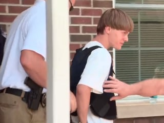 Charleston Church Shooting Suspect Escorted From Police Station