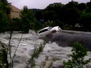 SUV Swept Away In Texas Floods