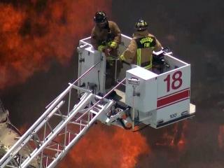 Firefighters Battle Massive Warehouse Blaze in Houston