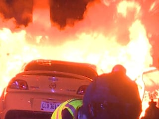 Cleveland Officers Pull Driver From Burning Car