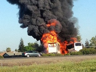 Fire Engulfs Deadly Bus Crash Site