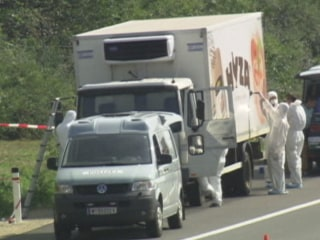 Forensic Experts Investigate Truck Full of Dead Refugees