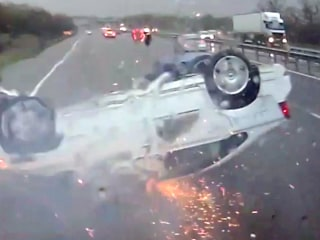 Miraculous Escape as Car Skids Along Highway on Its Roof