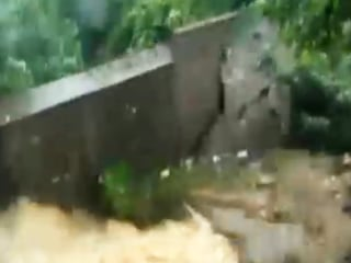 Caught On Camera: Flash Flood Wall Collapse