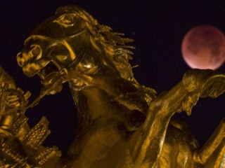 Supermoon's Red Hue Captured Around the World