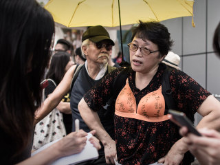 Woman Jailed for Assaulting Policeman With Her Breast at Protest