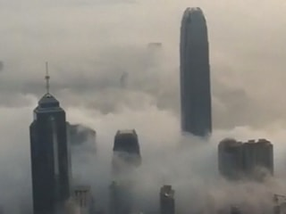 Dense Fog Shrouds Hong Kong's Skyline