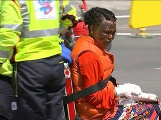 Burned Migrants Rescued from Sinking Dinghy