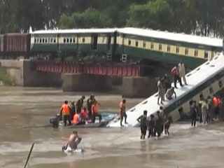 Bridge Collapse Plunges Train Into Canal