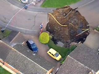 Massive Sinkhole in Residential Street Forces Evacuation