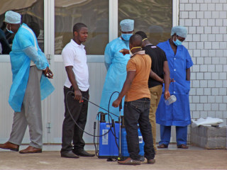 Medical Staff Scanning For Ebola At Guinea's Airport