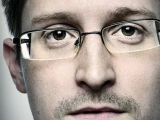 Edward Snowden Draped In Flag on WIRED Cover