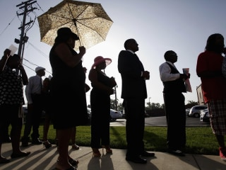 Thousands of Mourners Pay Respects to Michael Brown