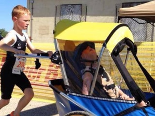 Little Triathlete Pushes, Pulls Brother Through Race