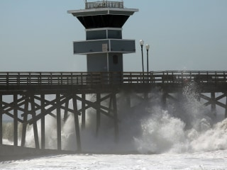 'Hero' Lifeguard Jumps From Pier to Rescue Swimmer From Surf