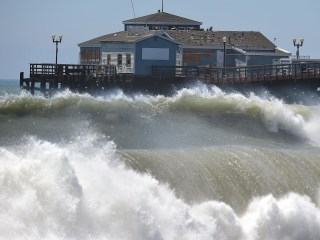 Huge Waves, Deadly Rip Currents Lash East and West Coasts