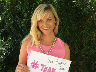 'Pink Lady' Reese Witherspoon Cheers on Boy With Cancer