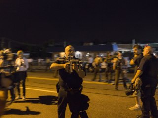 Missouri Cop Resigns After Pointing Rifle at Ferguson Protesters