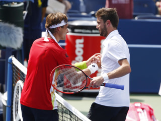 'Ultimate Grinder' Ferrer Ousted by No. 26 Seed Simon