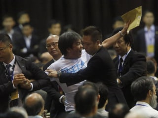 Hong Kong Pro-Democracy Activists Heckle Chinese Official