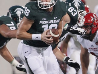 Michigan State QB Accuses Rival of 'Really Dirty Hit'