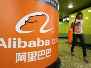 Alibaba Singles' Day tops $30 billion, but growth rate plunges