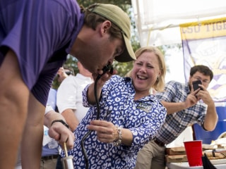 Senator Mary Landrieu Gives Keg Stand Assist at LSU Tailgate Party
