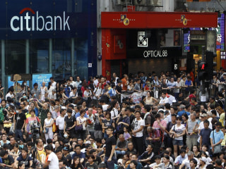 Hong Kong Unrest Weighs on Stock Markets: Dow Drops