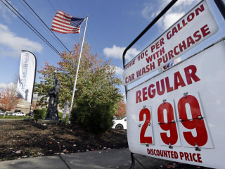 Gas Prices Slide to Four-Year Low Ahead of Busy Travel Week