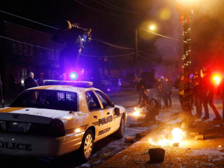 Flare-Up: Ferguson Protesters Torch Police Car After Calm