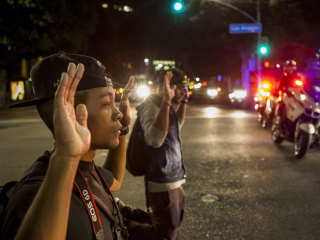 Calm in Ferguson While Police Arrest 130-Plus in L.A. and Oakland