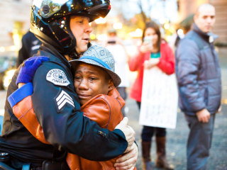 Portland Cop Asks Young Boy For Hug at Rally for Ferguson