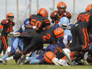 Youth Football May Factor into Memory Lapses in NFL Vets: Study