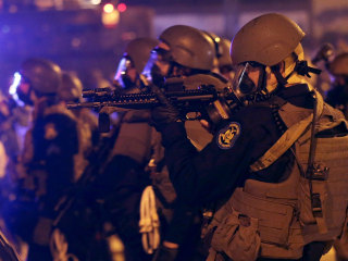 Ferguson Police Begin Testing 'Less Lethal' Gun Attachment