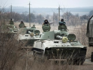Ukraine and Rebels Start Pulling Back Heavy Weapons in Restive East