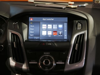Demand for High-Tech Puts Automakers on Horns of Dilemma