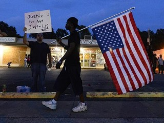 Holder Slams Ferguson Cops for Racist, Money-Grubbing Practices